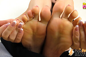 Teen takes socks off and shows soles